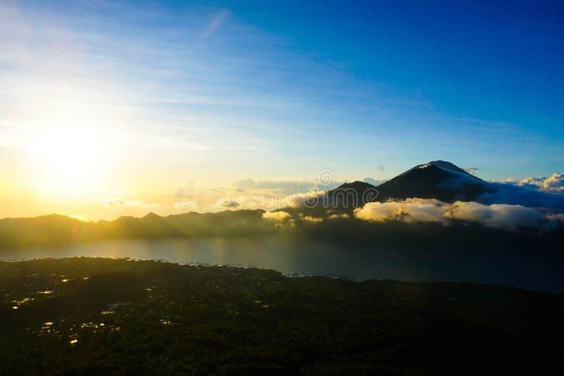 Sunrise Over Lake Batur. The sun rises and casts a golden haze over Bali`s Lake Batur stock image