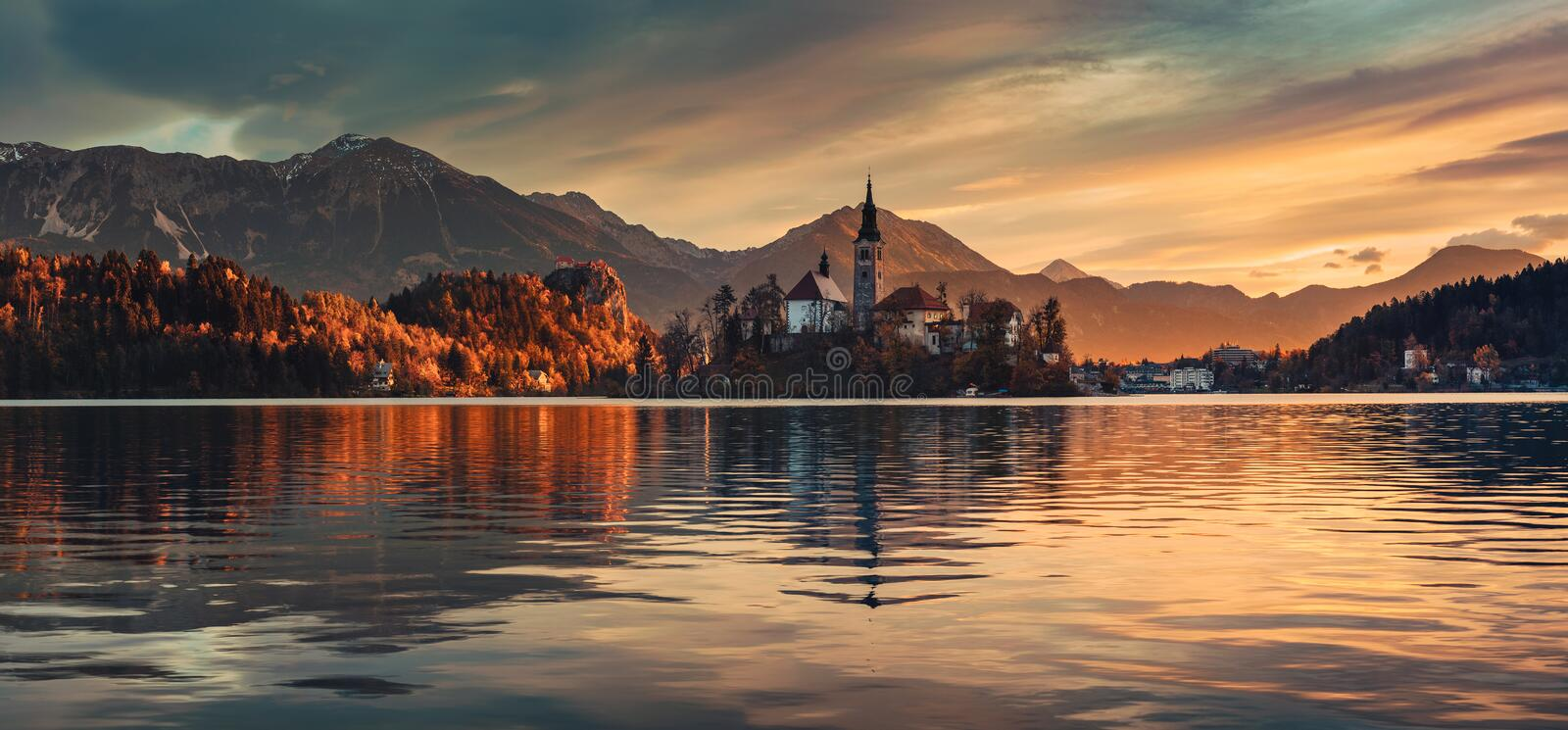 Sunrise over Lake Bled with St. Marys Church of the Assumption on the small i stock photos