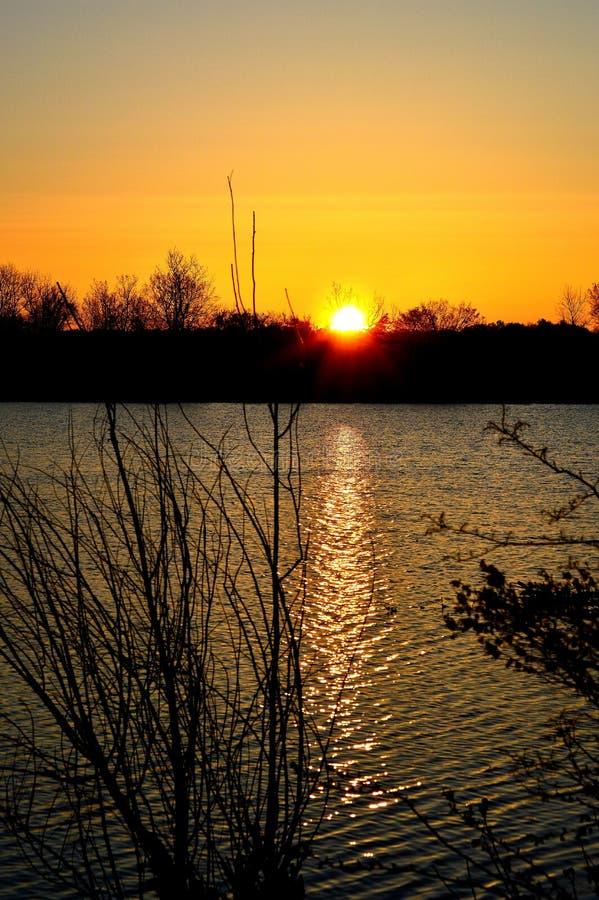 Sunrise over lake stock images
