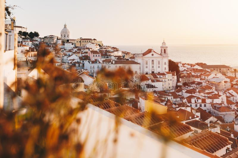 Sunrise Over Lisbon Old Town Alfama - Portugal. Lisbon Golden Hour Skyline. Balcony View on Alfama Old Town of Lisbon and Tagus. Sunrise Over Lisbon Old Town stock photo