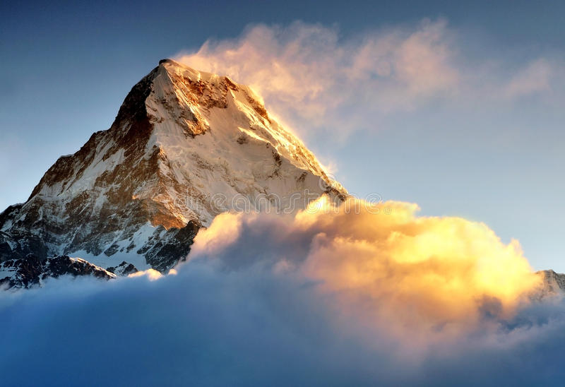 Sunrise over Machapuchare or fish tail mountain. Himalayan mountain peak during sunrise, Machapuchare or Fishtail peak in Nepal royalty free stock images