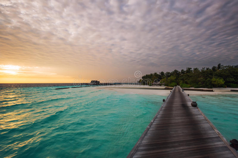 Sunrise over a Maldivian Island. Sunrise with impressive clouds over a Maldivian Island royalty free stock photography