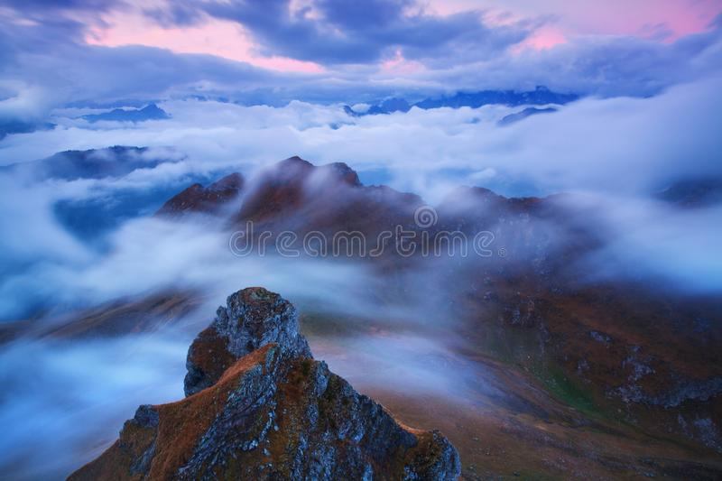 Sunrise Over Misty Landscape. Scenic View Of Foggy Morning Sky With Rising Sun Above Misty Forest. Middle Summer Nature Of Europe. Fantastic mountains stock photography