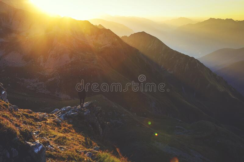 Sunrise over mountains royalty free stock images