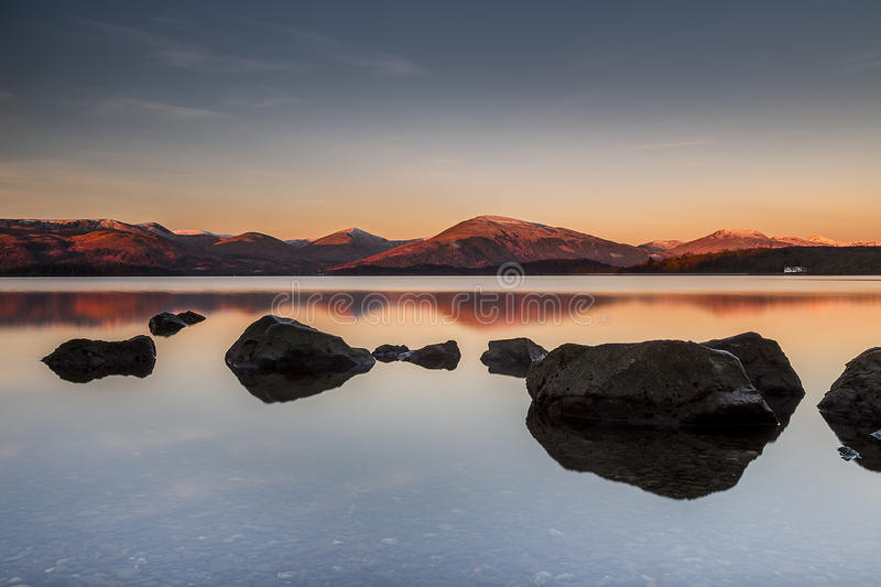Sunrise over mountains and rocks Milarrochy Bay stock images