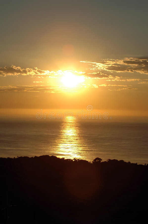Sunrise over the ocean stock photography
