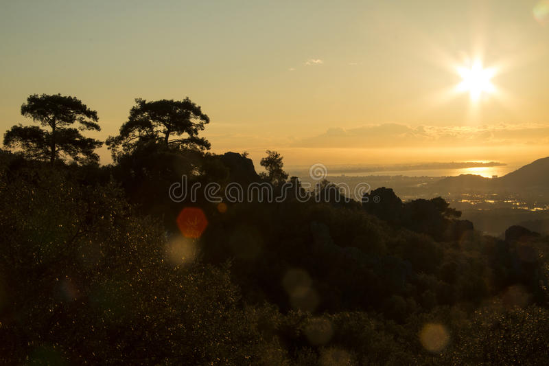 A sunrise over the ocean stock images