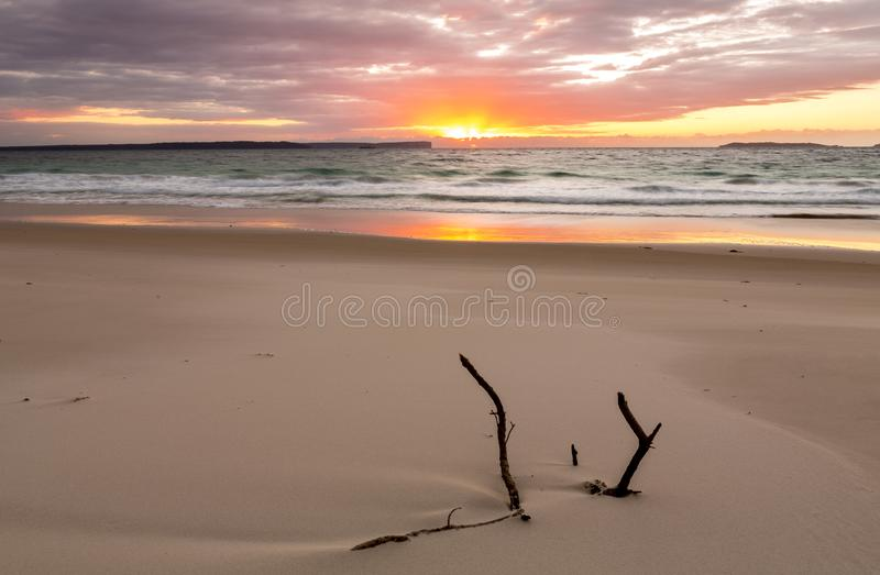 Sunrise over the ocean with beautiful unspoilt beach stock photo