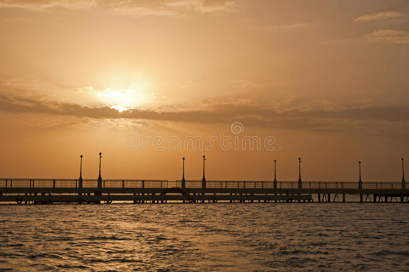 Sunrise Over The Ocean At A Pier Royalty Free Stock Images