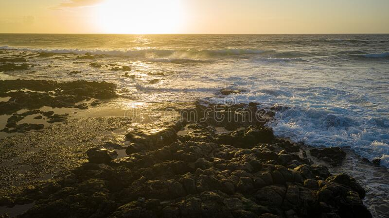 Sunrise over the Pacific Ocean from the Ke One Kula Lookout at Wawamalu Beach Park. In Hawaii royalty free stock photography