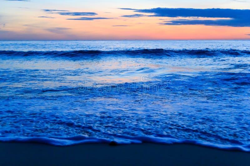 Sunrise over pacific ocean stock image