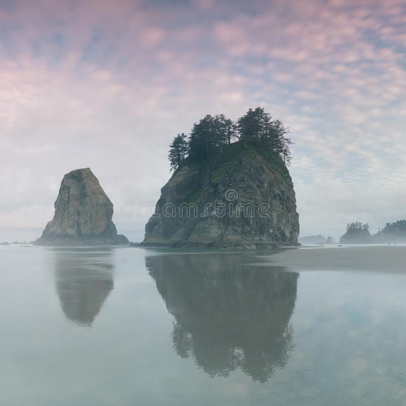 Sunrise over the Pacific through sea arches at a beach in Olympic National Park,  La Push, Washington, USA West coast. Sunrise over the Pacific through sea stock photography
