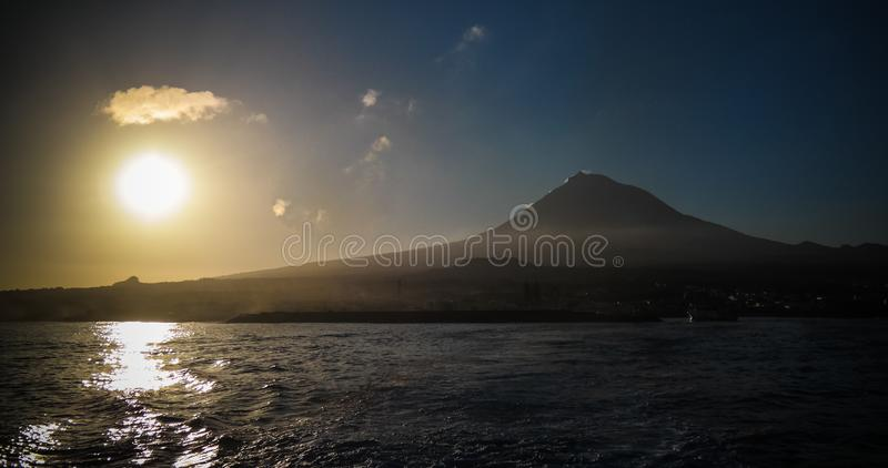Sunrise over Pico volcano and island, Azores, Portugal. Sunrise over Pico volcano and island in Azores, Portugal royalty free stock image