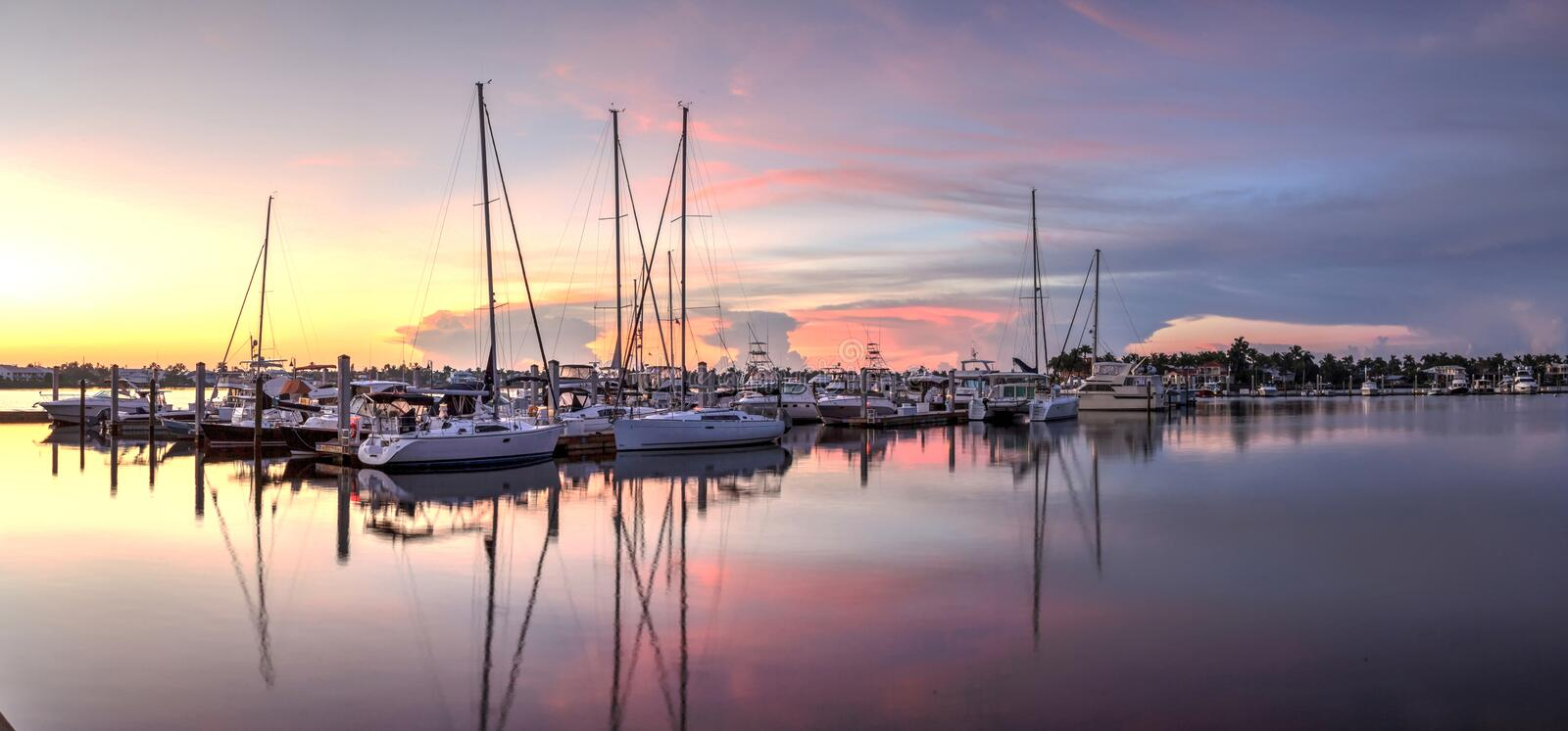 Sunrise over a quiet harbor in old Naples, Florida royalty free stock photo