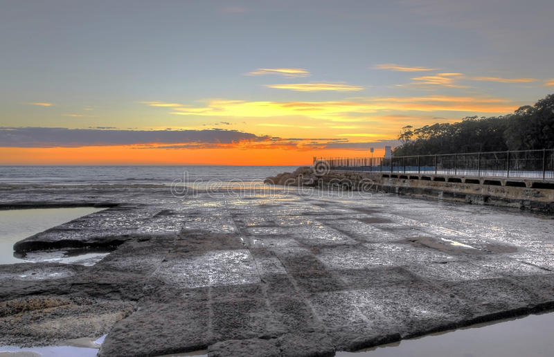 Download Sunrise over a rock pool stock image. Image of holiday - 20038161