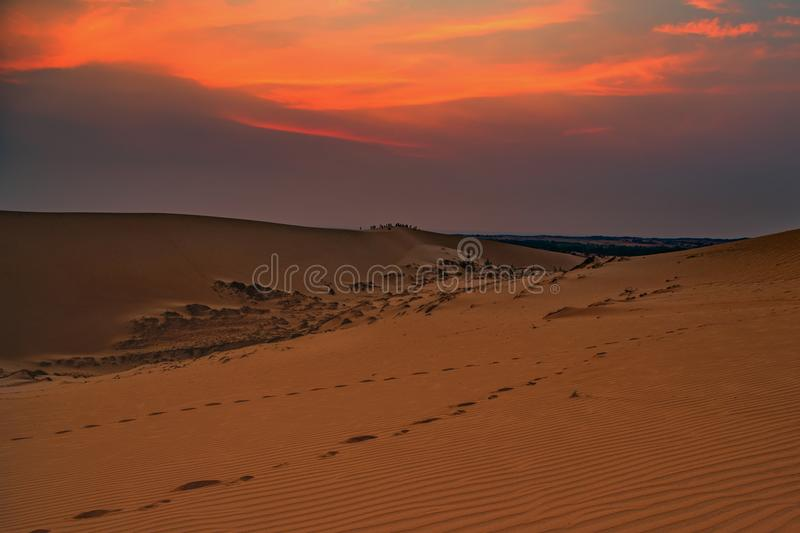 Sunrise over sand dune royalty free stock images