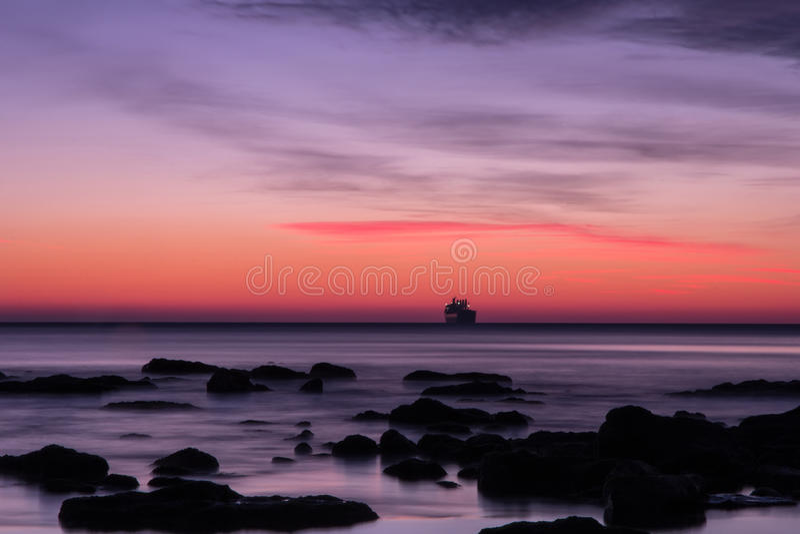 Before sunrise over the sea stock image