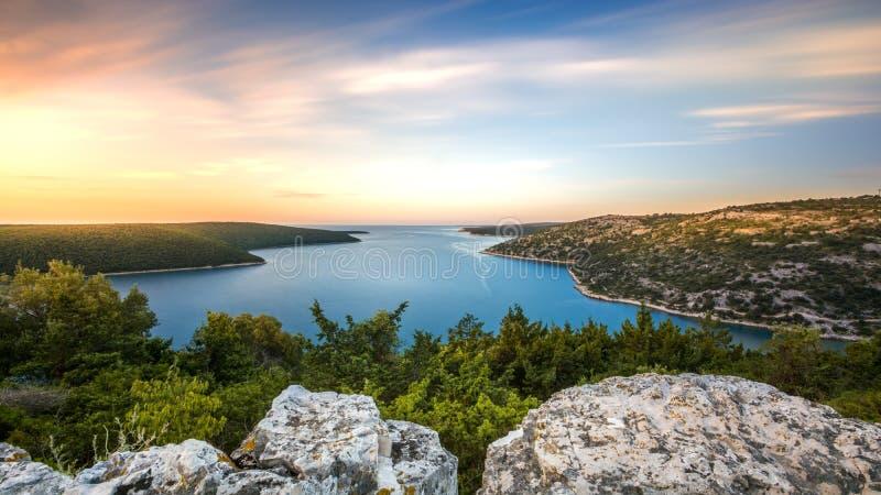 Sunrise over the sea bay Istria Croatia royalty free stock images
