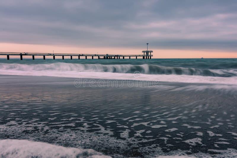 Sunrise over the sea bridge in Burgas bay, Bulgaria.  royalty free stock photography