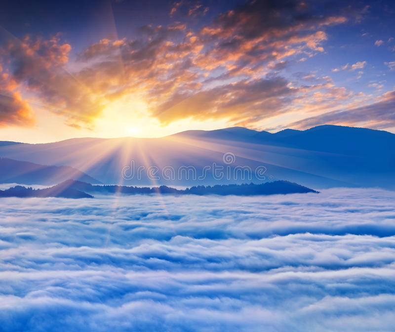 Sunrise over the sea of fog. In the mountains at the summer stock images
