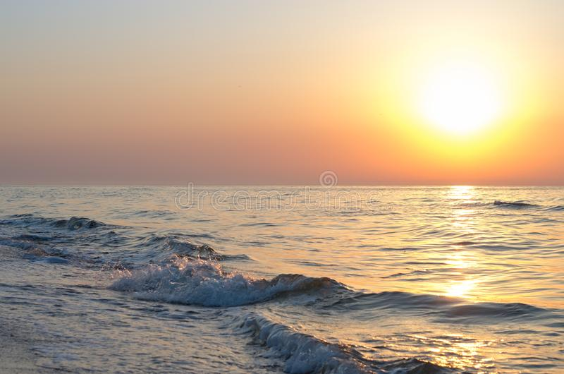 Sunrise over the sea horizon, waves royalty free stock images