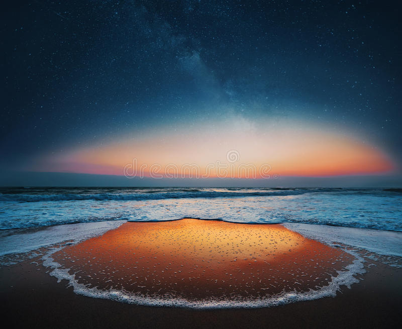 Sunrise over the sea and milky way sky stock photography