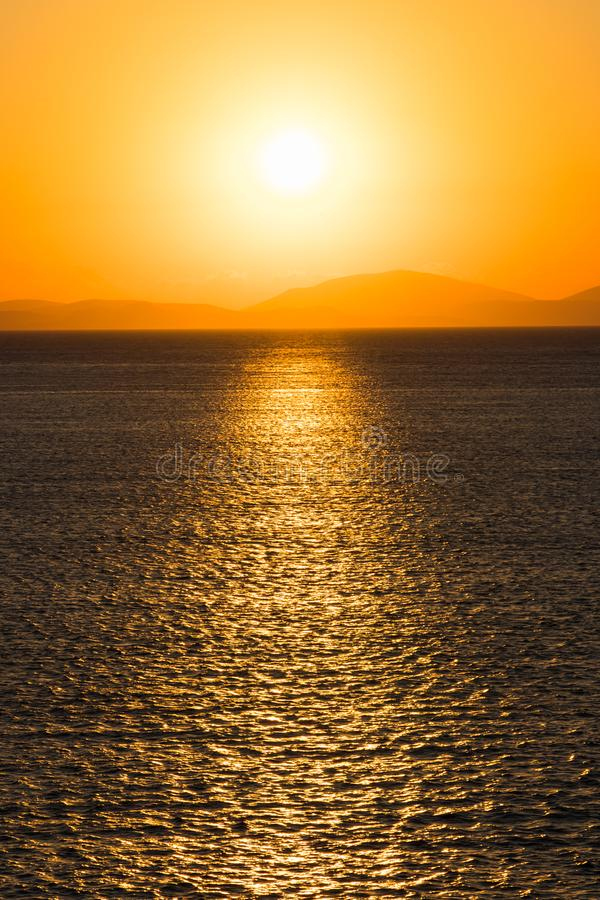 Sunrise over the sea and mountains on the horizon. royalty free stock image