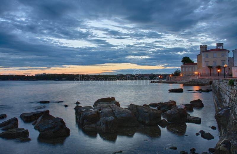 Sunrise over the sea in Porec in Croatia stock photos