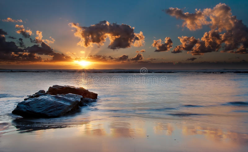 Sunrise over the sea with the sun's reflection stock image