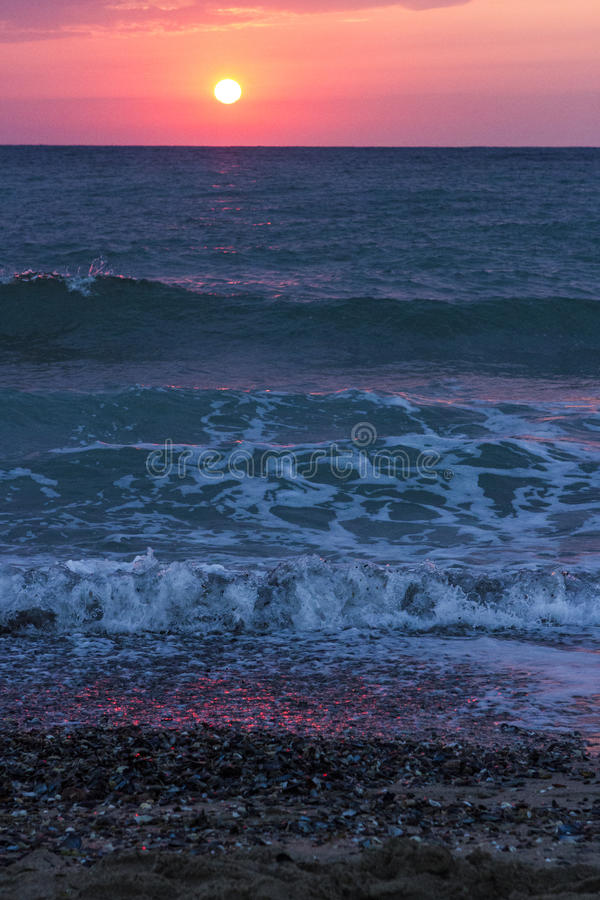 Sunrise over the sea and waves royalty free stock photo