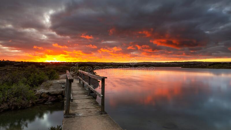 Sunrise over the small foot bridge located on the Onkaparinga River in Port Noarlunga South Australia on 30th March 2020 stock photography