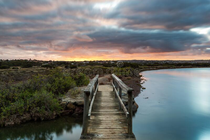 Sunrise over the small foot bridge located on the Onkaparinga River in Port Noarlunga South Australia on 30th March 2020 royalty free stock images