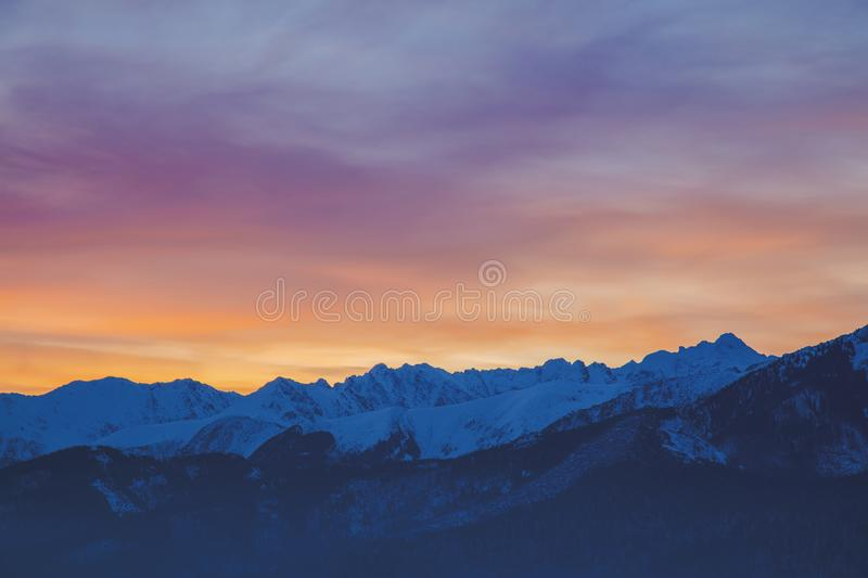 Sunrise over snow Tatry mountains. In winter time royalty free stock images