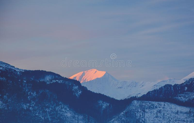 Sunrise over snow Tatry mountains. In winter time stock photos