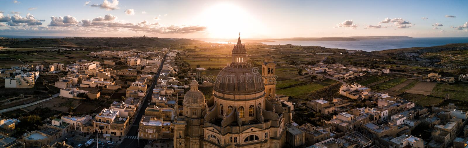 Sunrise over St. John Baptist Church. Gozo, Malta royalty free stock image