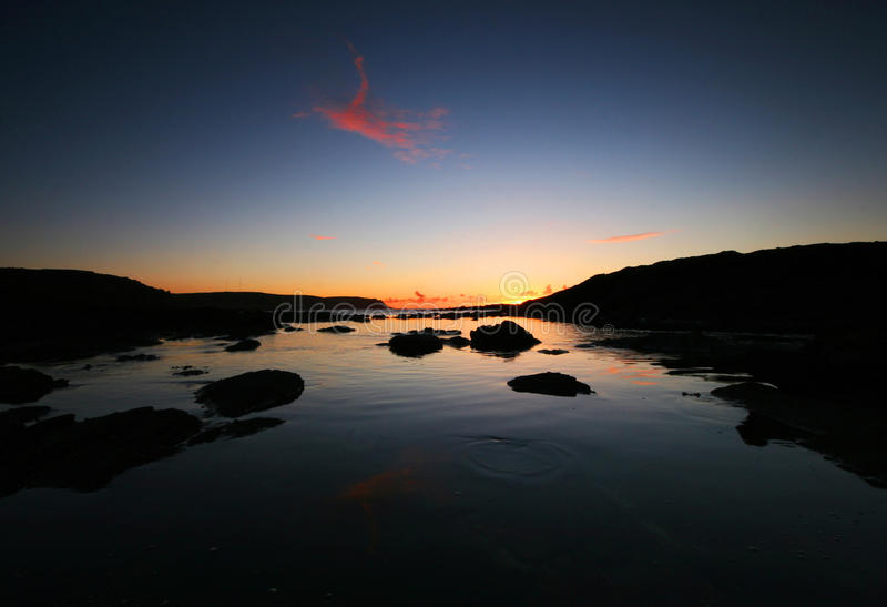 Download Sunrise Over Start Point Devon Stock Image - Image: 12564161