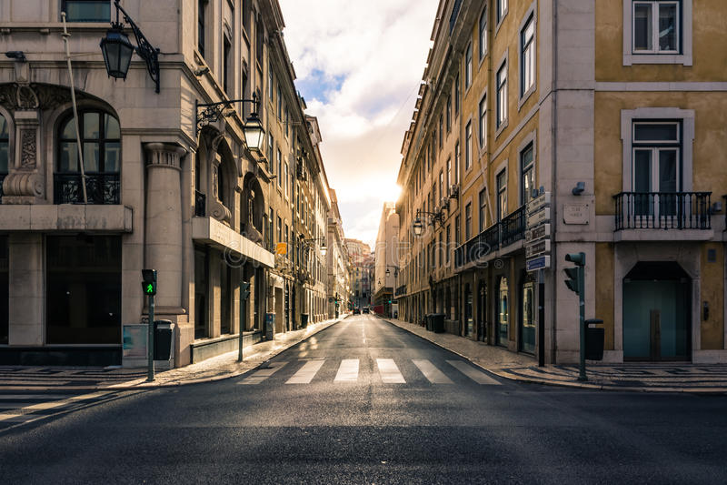 Sunrise over Street in City Center Lisbon Portugal Historic Euro royalty free stock photos