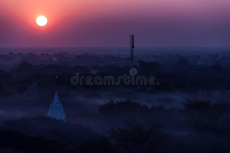 Sunrise over temples of misty and foggy Bagan in stock photography