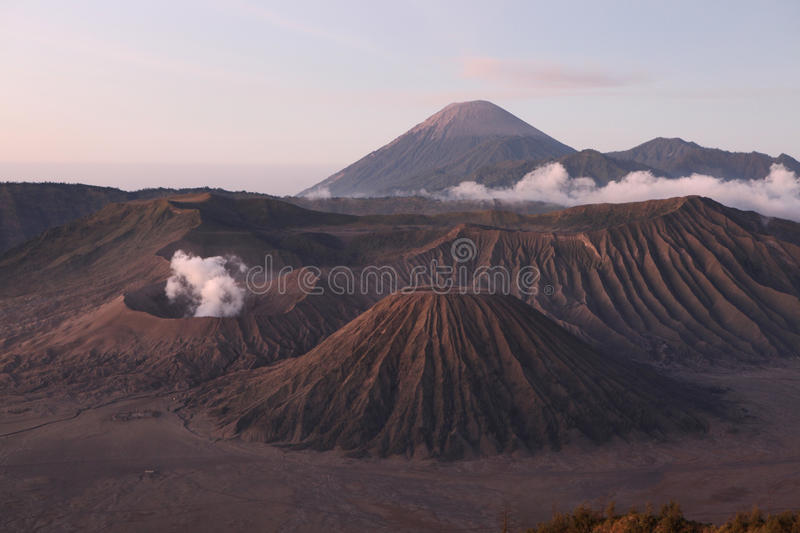 Sunrise over the Tengger Caldera in East Java, Indonesia. Sunrise over the volcanoes of the Tengger Caldera in East Java, Indonesia, pictured from Mount royalty free stock photography
