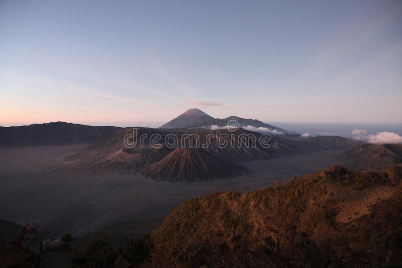 Sunrise over the Tengger Caldera in East Java, Indonesia. Sunrise over the volcanoes of the Tengger Caldera in East Java, Indonesia, pictured from Mount royalty free stock image