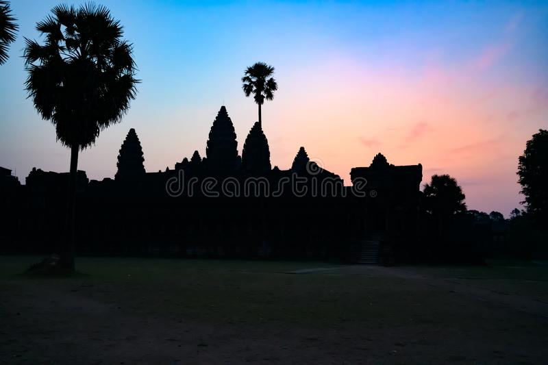 Angkor Wat, sunrise over ancient Temple, Siem Reap, Cambodia. Sunrise over the towers of Ankor Wat, the largest Hindu Temple in the world. Angkor Wat built in stock photo