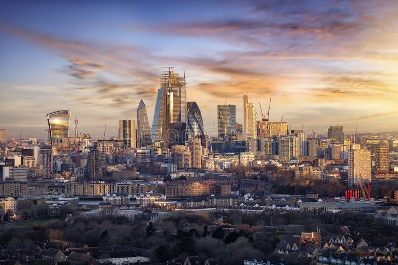 Sunrise over the urban skyline of the City of London, UK. Financial district and hub of banking institutions royalty free stock images