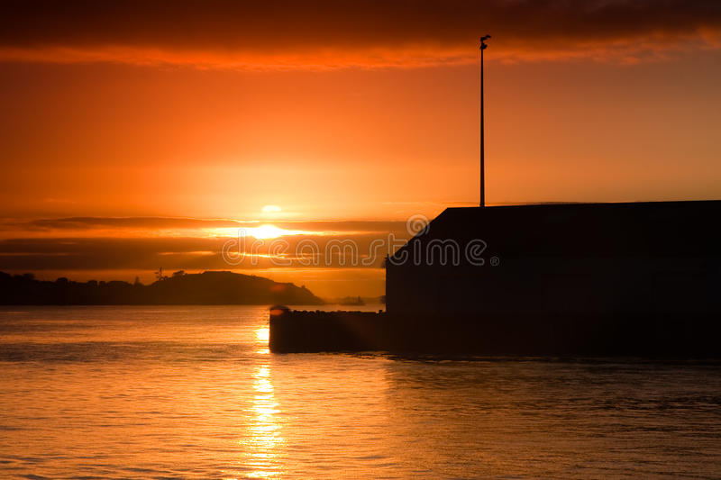 Download Sunrise Over A Wharf Building Stock Photo - Image of dawn, morning: 10648260