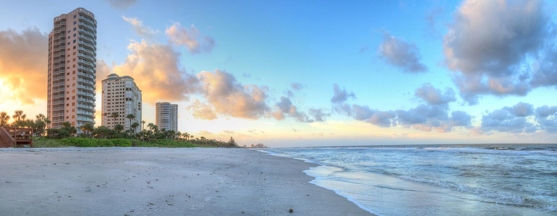 Sunrise over the white sand of Vanderbilt Beach in Naples. Florida stock photo