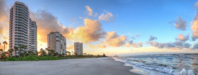 Sunrise over the white sand of Vanderbilt Beach in Naples. Florida stock image