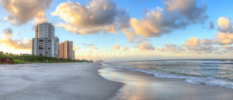 Sunrise over the white sand of Vanderbilt Beach in Naples. Florida royalty free stock photo