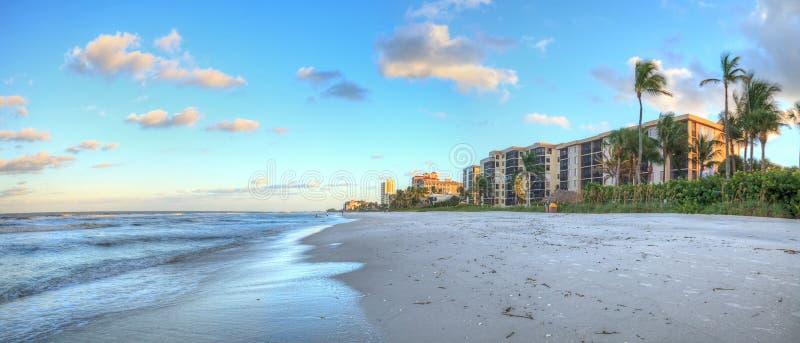 Sunrise over the white sand of Vanderbilt Beach in Naples. Florida royalty free stock images
