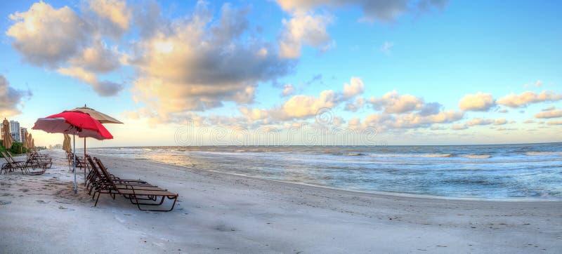 Sunrise over the white sand of Vanderbilt Beach in Naples. Florida stock images