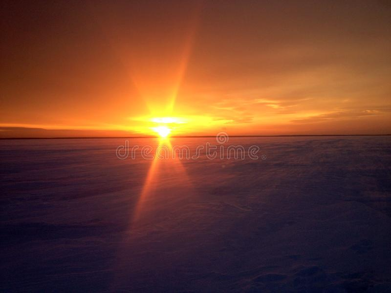 Sunrise over the winter desert in the Vologda region, the Volga-Baltic canal royalty free stock photo