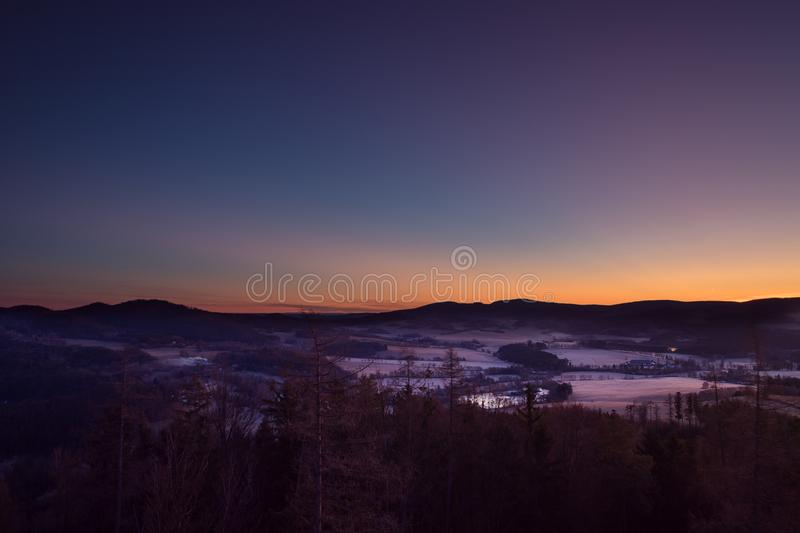 Sunrise over winter landscape in the mountains stock photo